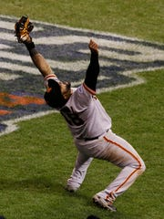 San Francisco third baseman Pablo Sandoval celebrates as he catches the final out in foul territory of the Giants' 3-2 victory over Kansas City in Game 7 of the World Series.