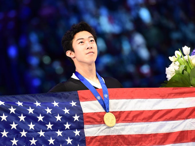 Gold medalist Nathan Chen poses on the podium of the