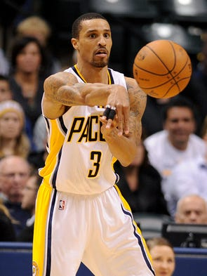 Indiana Pacers guard George Hill passes the ball against the Portland Trail Blazers inside Bankers Life Fieldhouse, Friday, February 7, 2014, in Indianapolis.