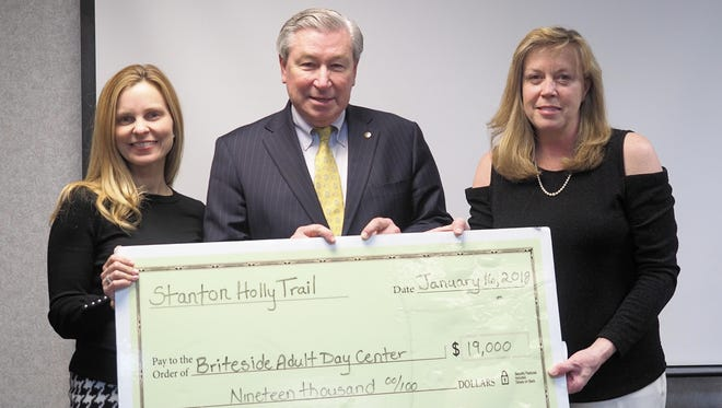 Cindi Troegner, chairwoman of Stanton Holly Trail, presents Robert Wise, CEO of Hunterdon Healthcare, and Christine O'Malley of the Hunterdon Healthcare Foundation with a $19,000 donation to be used for Briteside Adult Day Center.