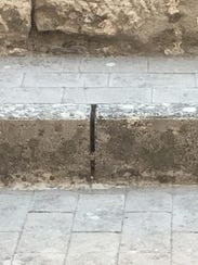 The crack in the sidewalk in Italy where Justin Mussel