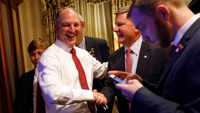 Louisiana Democratic gubernatorial candidate Rep. John Bel Edwards greets supporters as he watches election returns in a hotel suite at his election night watch party in New Orleans.