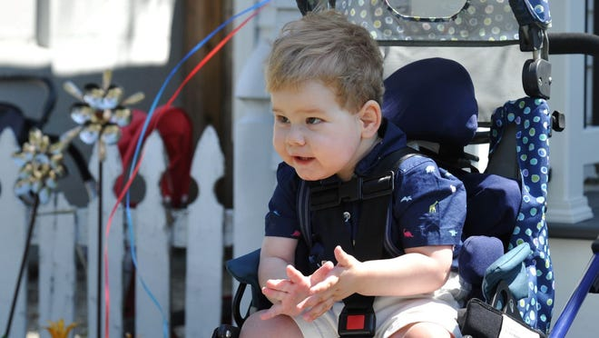 Hunter Osborne applauds a drive-by parade at his North Weymouth home celebrating his third birthday on Friday, June 26, 2020.
