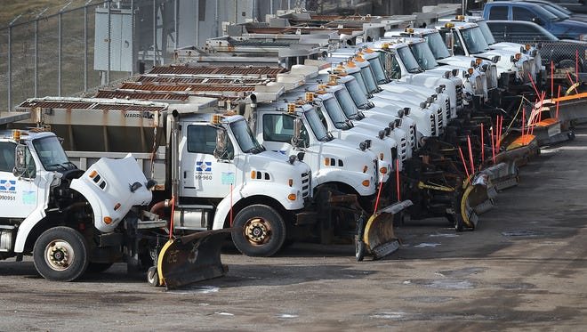 Indianapolis Department of Public Works trucks with plows are lined up, ready for duty, on Monday, Jan. 5, 2015.