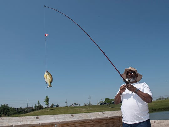 Ezell Robinson Jr. reels in his catch.