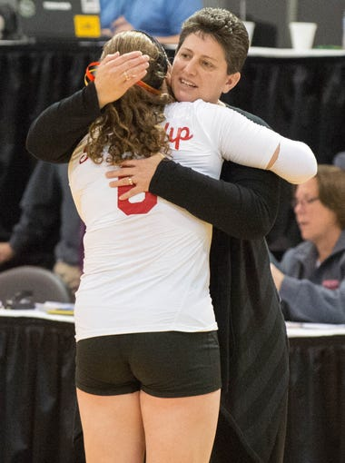 St. Philip's head coach Vicky Groat hugs Kameron Haley after the game.