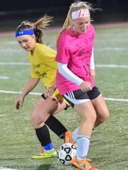 McKenzi Garlock (8) and Hannah Statler (11) battle it out for possession of the ball during the 4-Diamonds All-Star soccer game on Wednesday, Nov. 9, 2016 in Greencastle, Pa.  Maryland All-Stars defeat Pennsylvannia 3-0 in 4-Diamonds girls game.