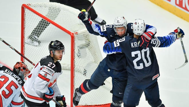 United State's Dylan Larkin (2nd R) and United States' Chris Kreider (R) celebrate scoring the 2-2 during the group B match US vs Canada of the 2018 IIHF Ice Hockey World Championship at the Jyske Bank Boxen in Herning, Denmark, on May 4, 2018.