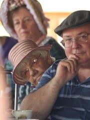 Bill Drumright, Lucile Telfer and Doris Meitzlen listen