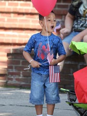 Raphandro Gaudio, 4, of Rochester reacts as he sees cars that are part of the 2017 Labor Day parade make their way toward Main Street from East Avenue.