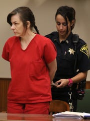 Laura Rideout is handcuffed and about to be led away to start serving her sentence.