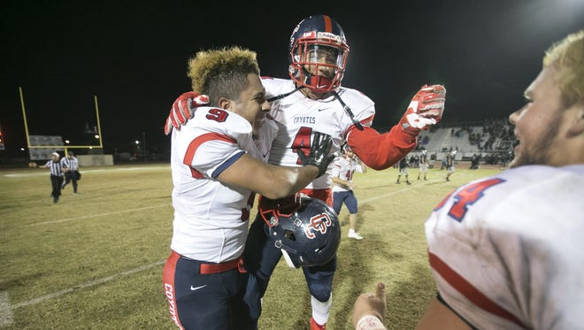 Centennial's (from left) Richard Valdez, Quentin Gomez and Jeff Durfee celebrate after Centennial's 34-23 come from behind win over Hamilton High in the quarter-final play-off game at Hamilton High in Chandler on Friday, November 13, 2015.