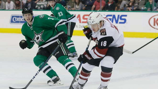 Arizona Coyotes center Christian Dvorak (18) skates with the puck against Dallas Stars defenseman John Klingberg (3) during the first period of an NHL hockey game in Dallas, Tuesday, April 4, 2017.