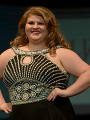 Shelby Thompson shows off her smile and dress on the runway at the 2016 Lights Camera Fashion Show on Saturday at the Carl Perkins Civic Center.