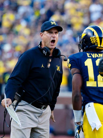 The Badgers face No. 5 Michigan, led by coach Jim Harbaugh,