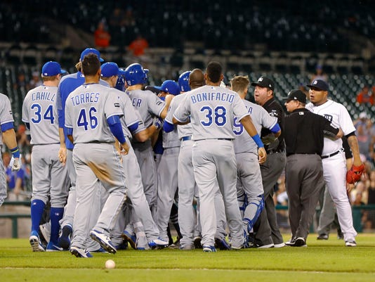 Kansas City Royals players charge the field after Detroit Tigers relief pitcher Bruce Rondon, right, hit Mike Moustakas with a pitch during the ninth inning of a baseball game in Detroit, Wednesday, July 26, 2017. (AP Photo/Paul Sancya)