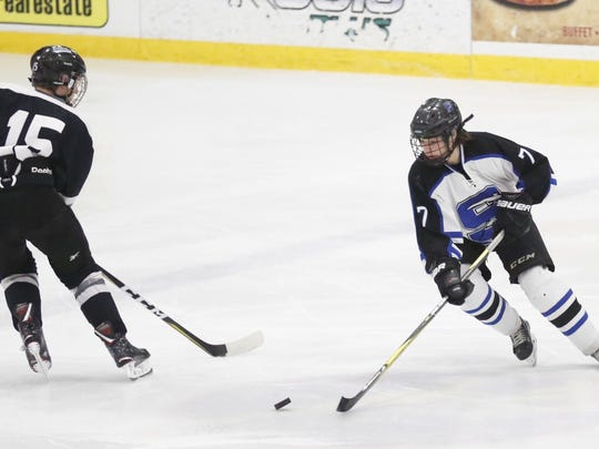 St. Mary's Springs Academy hockey's Jack Sabel works
