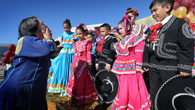 El Paso icon Rosa Guerrero blows kisses at members of the Rosa Guerrero Elementary School Folklorico Club after they performed at the school's 25th anniversary celebration Wednesday.