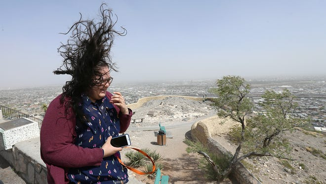 Andrea Perez braves high winds Thursday to look out from Scenic Drive. Winds were expected to gust up to 65 miles per hour Thursday through Friday morning.