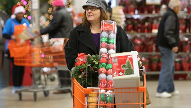 Thea Winter shops for Christmas decorations at Home Depot, at 3902 N. High School Rd., during Black Friday shopping.