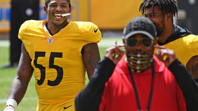 Pittsburgh Steelers linebacker Devin Bush jokes with head coach Mike Tomlin during an afternoon NFL football practice, Friday, Aug. 21, 2020, at Heinz Field in Pittsburgh.