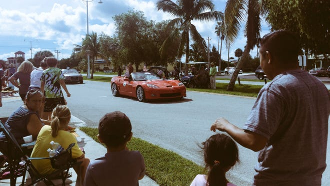 Families watch the Everglades City Fourth of July parade July 1, 2017.