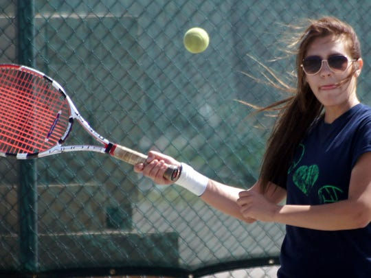 Senior Lady Cat Deanne Borden rallied for victories in singles and doubles to lead the Lady Wildcats to a convincing 8-1 dual team victory over Gadsden High Tuesday.
