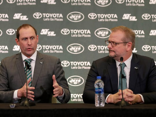 New York Jets head coach Adam Gase, left, speaks while general manager Mike Maccagnan looks on during a news conference in Florham Park, N.J., Monday, Jan. 14, 2019. (AP Photo/Seth Wenig)