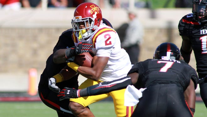 Iowa State Cyclones running back Aaron Winmberly (2) rushes against the Texas Tech Red Raiders in the first half of a 2013 game.