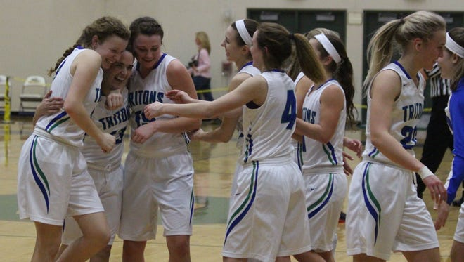 Green Bay Notre Dame senior Katelyn Morgan (left, middle) celebrates with teammates after scoring her first points of the season Friday against Sheboygan South. Morgan missed a majority of the season with a torn ACL.