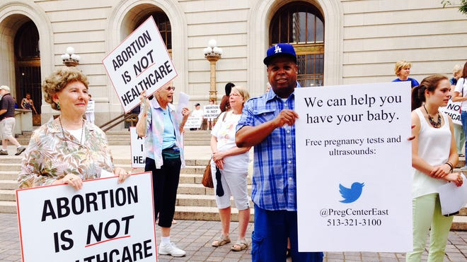 Anti-abortion protesters demonstrate June 30 outside a hearing related to an abortion clinic's appeal of the state's order to close.