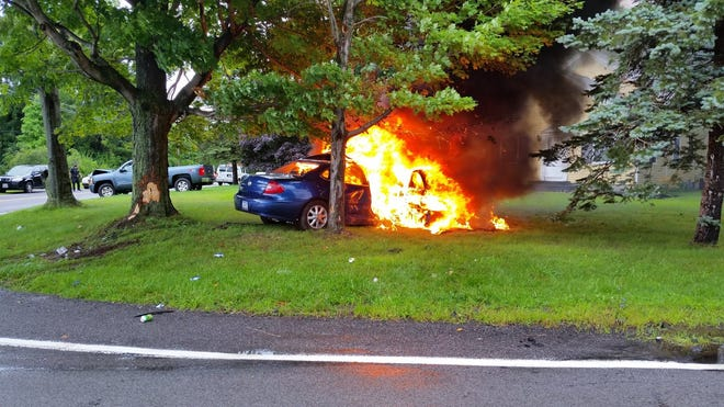 A car became engulfed in flames following a crash at Woodard and Basket roads in Webster Monday afternoon.