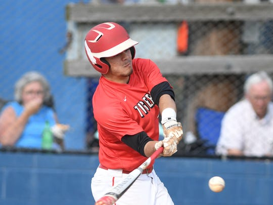 Lexington's Evan Gilliam (4) takes a swing at a pitch during the District 14-AA championship game against McNairy Central on May 11. Lexington defeated McNairy14-6.