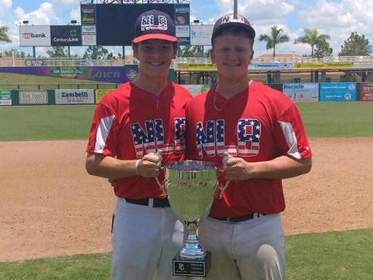Next Level Baseball catcher Dallen Leach (right) celebrates a Perfect Game Southeast Championship win with his Lincoln teammate Shawn Snyder.