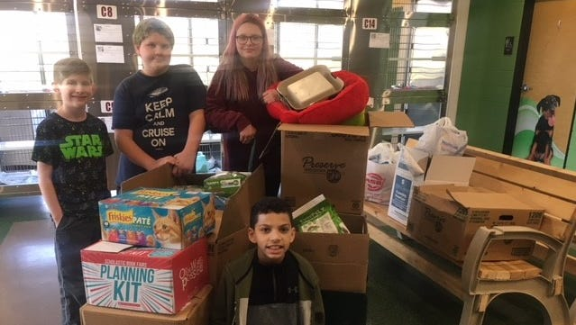 Students from Cason Lane Academy Jr. Beta Club hosted a donation drive for Pet Adoption and Welfare Services during Read Across America week.