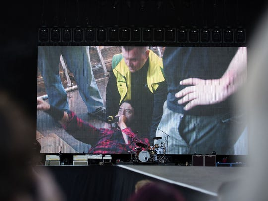 Foo Fighters' Dave Grohl is pictured on a big screen