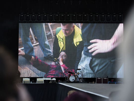 Foo Fighters' Dave Grohl is pictured on a big screen moments after breaking his leg during a June 12 show in Sweden.