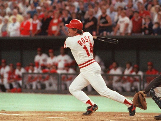 Pete Rose hits a line drive Sept.11,1985 in Cincinnati to break Ty Cobb's all-time hits record.