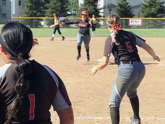 Simpson's Mia Olvera runs to join teammates to celebrate