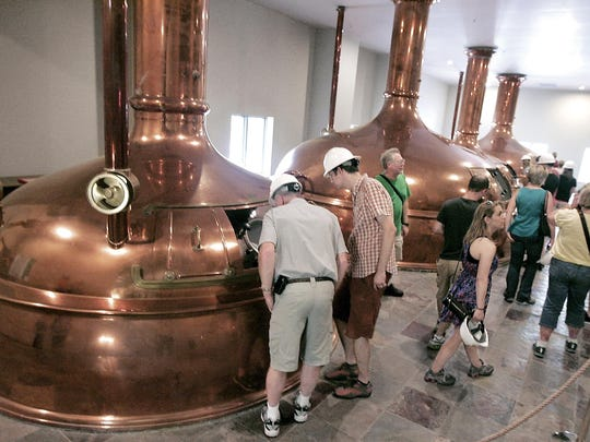 Tourists go through the New Glarus Brewing Co.'s hilltop facility in New Glarus. Sales of Spotted Cow, the brewery's signature beer, have grown more than 1,000 percent since 2000. Co-founder Deb Carey was the first woman to found and operate a brewery in the United States. She launched New Glarus with her husband, Dan, in 1993.