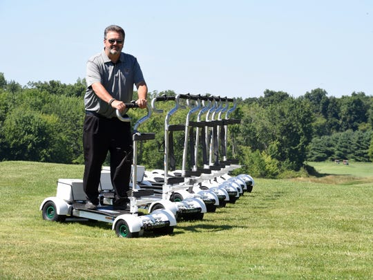 Rob Caeners, general manager at The Links at Union Vale, steps onto a GolfBoard during Wednesday's demo day. The Links at Union Vale is the first golf course in the Mid-Hudson Valley to start offering Golfboards to their members.
