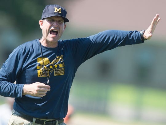 Michigan Head Coach Jim Harbaugh yells during Coach Jim Harbaugh's Elite Summer Football Camp at Prattville High School in Prattville, Ala., on Friday, June 5, 2015.