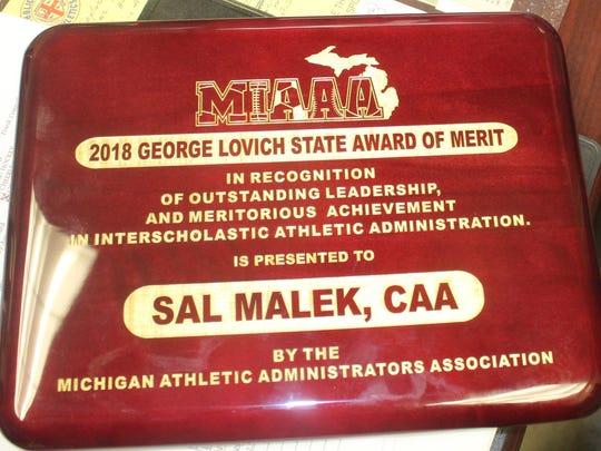 Sal Malek's State Award of Merit plaque up close.