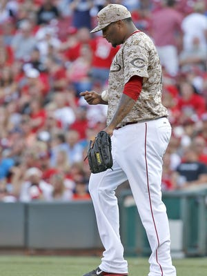Cincinnati Reds relief pitcher Jumbo Diaz (70) walks back to the mound after surrounding the go-ahead two-run single to San Diego Padres right fielder Matt Kemp (27) in the eighth inning of the Major League Baseball game between the Cincinnati Reds and the San Diego Padres, Saturday, June, 6 2015.