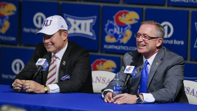 Kansas football in winless across its first three games this season, but athletic director Jeff Long, right, said Wednesday that second-year head coach Les Miles, left, is rebuilding the program the right way.