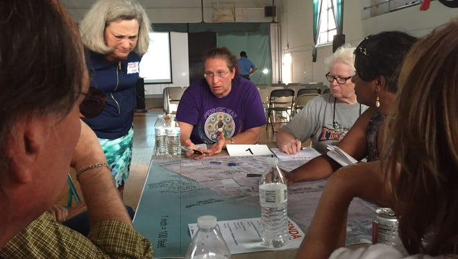 From left to right, Angela Hicks with Hamilton Anderson Associates, Jo-Ann Sheffer of Detroit and Maryanne Dunmire of Royal Oak discuss improvements to Historic Ft. Wayne at the Visitors Center in southwest Detroit on Tuesday.