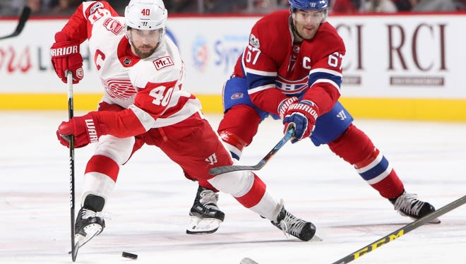 Dec 2, 2017; Montreal, Quebec, CAN; Detroit Red Wings center Henrik Zetterberg (40) plays the puck against Montreal Canadiens left wing Max Pacioretty (67) during the second period at Bell Centre.