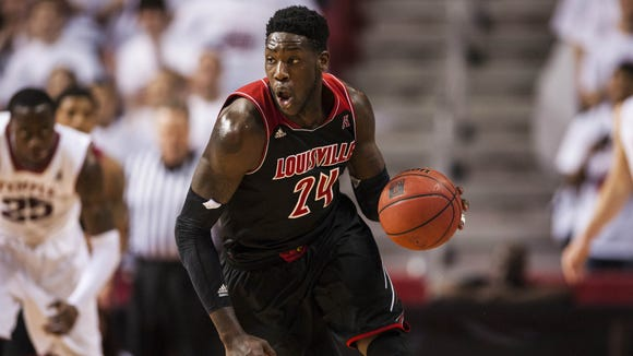 Feb 14, 2014; Philadelphia, PA, USA; Louisville Cardinals forward Montrezl Harrell (24) brings the ball up court during the first half against the Temple Owls at the Liacouras Center. Louisville defeated Temple 82-58. Mandatory Credit: Howard Smith-USA TODAY Sports