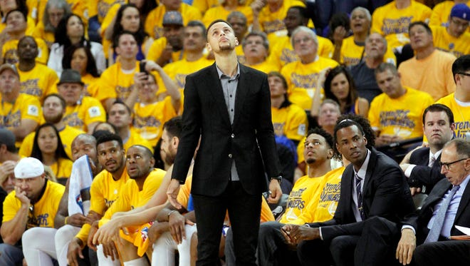 Golden State Warriors guard Stephen Curry looks up towards the scoreboard during action against the Houston Rockets in the second quarter of Game 2.
