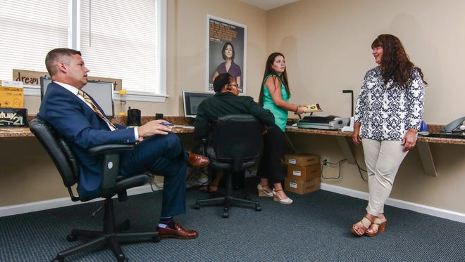 Gold Key Realty franchise owner Danielle Benson (right) meets with staff June 27 in Newark. The firm ranked in third place in the small business category in the 2016 Top Workplaces survey.